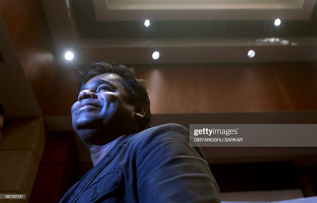 Indian composer, singer, song-writer, music producer, and multi-instrumentalist, A.R. Rahman leaves after a press conference to announce the 'Rahmanishq' music concert in Kolkata on September 28, 2013. Music lovers are waiting for October 1st live concert of this two Academy Awards winner for his work in Slumdog Millionaire. AFP PHOTO / Dibyangshu SARKAR