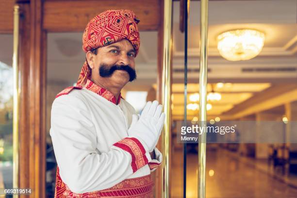 Indian Concierge Welcome Guest at Hotel Entrance Agra India