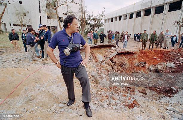 Indian conductor Zubin Mehta visits the site of the first Iraqi Scud missile strike of the Gulf War in Tel Aviv Israel January 1991