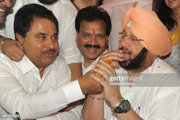 Indian Congress leader and National Commission for Scheduled Castes Vice Chairman Raj Kumar Verka and member of the Legislative Assembly Om Parkash...