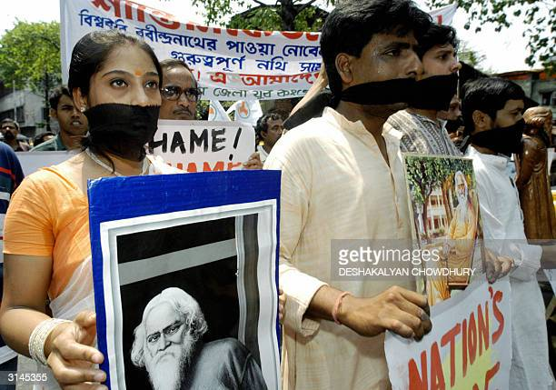 Indian Congress Party activists stage a silent protest as they display photographs of 1913 Nobel lauriate Rabindranath Tagore in Calcutta 27 March...