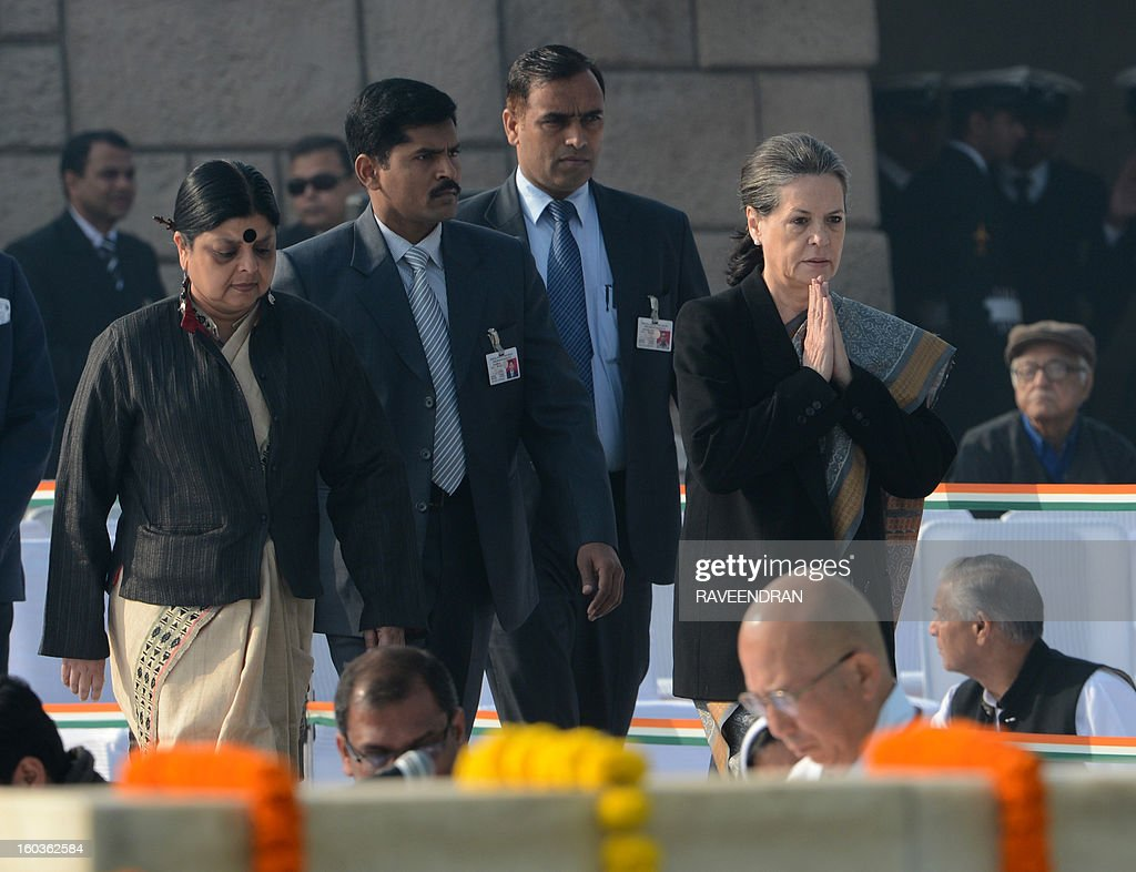 Indian Congress Party President and chairperson of the UPA Government Sonia Gandhi (R) pays homage at Rajghat, the memorial of India's founding father Mahatma Gandhi, on Martyrs Day in New Delhi on January 30, 2013, the 65th anniversary of Gandhi's assassination. Mahatma Gandhi was on the way to a prayer meeting in the Indian capital when he was shot three times in the chest and head on January 30, 1948.