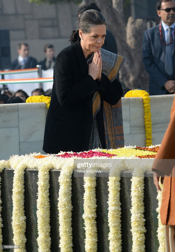 Indian Congress Party President and Chairperson of UPA Government, Sonia Gandhi pays homage at Rajghat, the memorial of India's founding father Mahatma Gandhi, on Martyrs Day in New Delhi on January 30, 2013, the 65th anniversary of Gandhi's assassination. Mahatma Gandhi was on the way to a prayer meeting in the Indian capital when he was shot three times in the chest and head on January 30, 1948. AFP PHOTO/ RAVEENDRAN