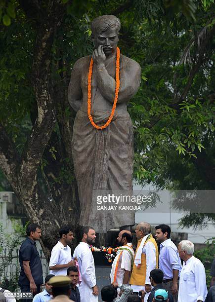 Indian Congress Party vice president Rahul Gandhi offers a tribute at the statue of freedom fighter Chandra Shekhar Azad before a roadshow in...