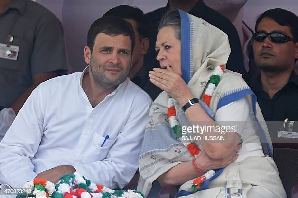Indian Congress Party vicepresident Rahul Gandhi and Congress President Sonia Gandhi talk during a rally in New Delhi on April 19 2015 Beleaguered...