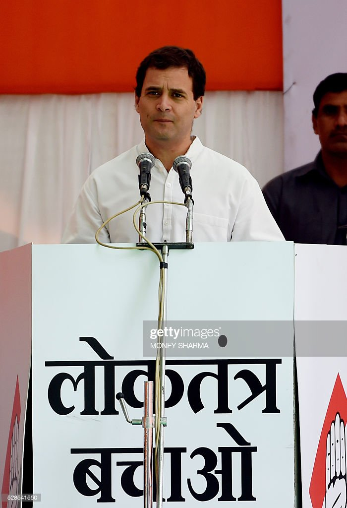 Indian Congress Party Vice-president Rahul Gandhi speaks during a protest in New Delhi on May 6, 2016. Former Indian prime minister Manmohan Singh, Congress Party President Sonia Gandhi and party Vice-president Rahul Gandhi were briefly arrested at a police station and later released during a 'Save Democracy' protest march against the ruling Bharatiya Janata Party (BJP). / AFP / MONEY