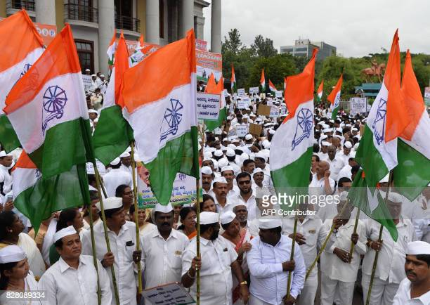 Indian Congress party workers hold preIndependence flags as they take part in a rally held to commemorate the 75th year of the Quit India freedom...