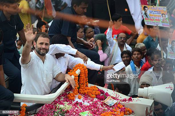 Indian Congress party's vice president and leader Rahul Gandhi waves towards supporters during a roadshow named as 'Kisan Yatra' in Allahabad on...