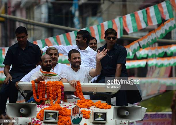 Indian Congress party's vice president and leader Rahul Gandhi waves during a roadshow named as 'Kisan Yatra' in Allahabad on September 15 2016 Rahul...