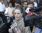 Indian Congress president Sonia Gandhi walks towards the Presidential Palace in protest against land reforms proposed by Prime Mnister Narendra Modi...