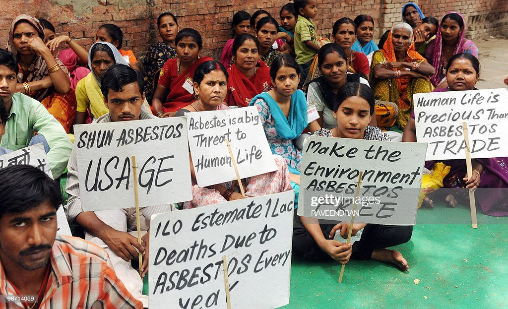 Indian construction workers hold a hunger strike against the use of asbestos in New Delhi on International Workers Memorial Day April 28 2010 The...