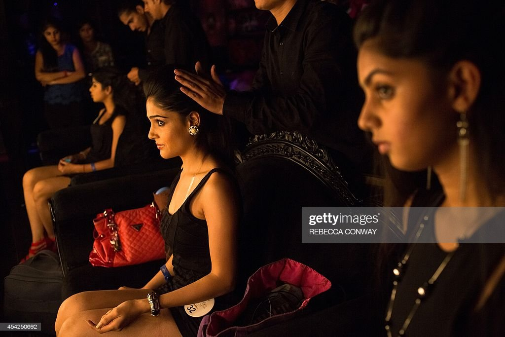 Indian contestants have their hair styled as they prepare to take part in the Miss Diva Universe 2014 auditions in New Delhi on August 27, 2014. The Miss Diva Universe 2014 pageant is holding auditions in ten cities across India ahead of the contest finale in September. AFP PHOTO/Rebecca Conway