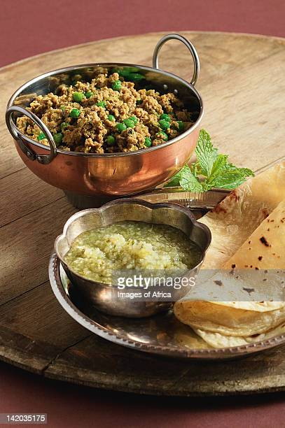 Indian cooking. Mince with peas and mint served with apple and mint chutney and roti