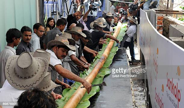Indian cooks lift a 325 foot long Dosa at Sankalp Resteraunt in Ahmedabad on August 19 2009 The dosa which took some sixteen cooks to prepare has...