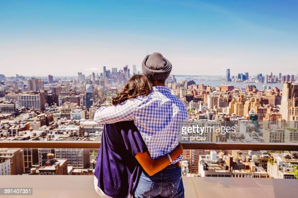 Indian couple admiring New York cityscape, New York, United States