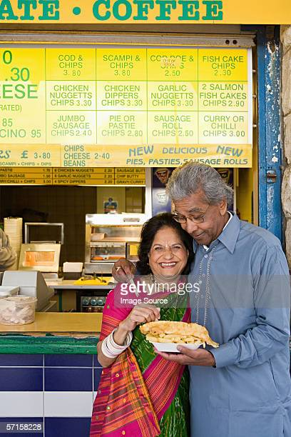 Indian couple having fish and chips