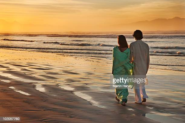 Indian couple on beach.