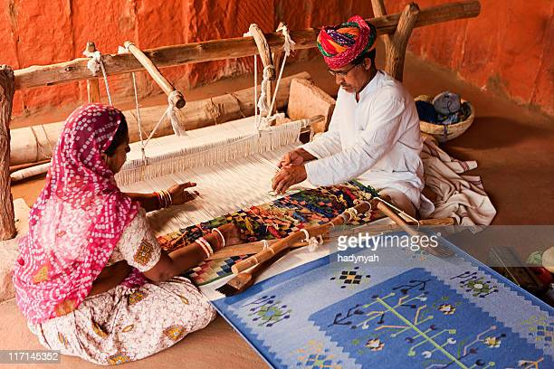 Indian couple weaving textiles (durry). Salawas village. Rajasthan.