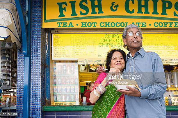 Indian couple with fish and chips