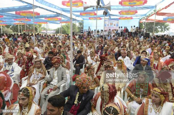 TOPSHOT Indian couples in traditional outfits take part in a mass wedding ceremony on the outskirts of Ahmedabad on February 5 2017 The mass wedding...