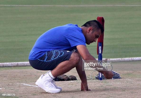 Indian Cricket captain MS Dhoni inspecting the pitch during the training session before the 2nd T20 match against South Africa at Barabati Stadium on...