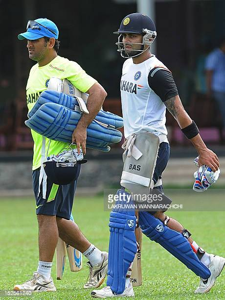 Indian cricket captain Mahendra Singh Dhoni and Virat Kohli arrive for a training session in Colombo on September 22 2012 AFP PHOTO/ LAKRUWAN...