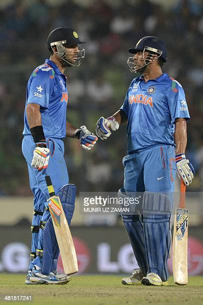 Indian cricket captain Mahendra Singh Dhoni celebrates with his teammate Yuvraj Singh after hitting a boundary during the ICC World Twenty20...