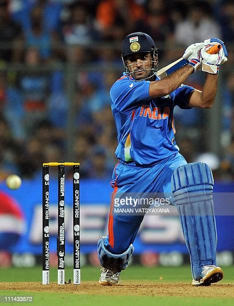 Indian cricket captain Mahendra Singh Dhoni plays a shot during the ICC Cricket World Cup 2011 Final match at The Wankhede Stadium in Mumbai on April...