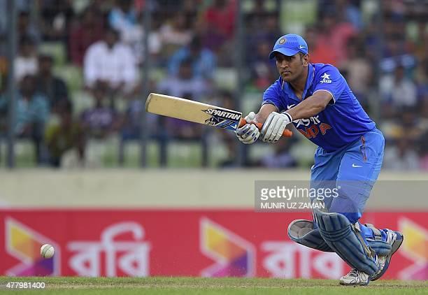 Indian cricket captain Mahendra Singh Dhoni plays a shot during the second ODI cricket match between Bangladesh and India at the ShereBangla National...