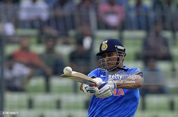 Indian cricket captain Mahendra Singh Dhoni plays a shot during the third ODI cricket match between Bangladesh and India at the ShereBangla National...