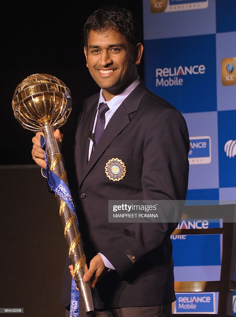 Indian cricket captain Mahendra Singh Dhoni poses with the Reliance Mobile ICC Test Championship mace in New Delhi on December 27 2009 India achieved...