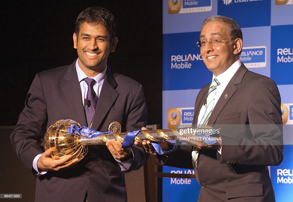 Indian cricket captain Mahendra Singh Dhoni receives the Reliance Mobile ICC Test Championship mace from ICC Chief Executive Haroon Lorgat in New...