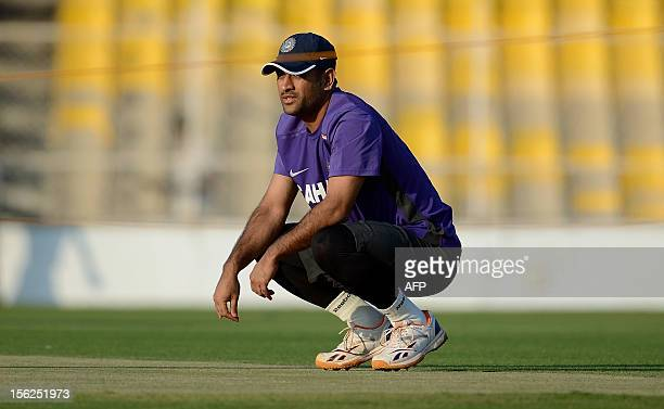 Indian cricket captain Mahendra Singh Dhoni sits during a training session at The Sardar Patel Stadium at Motera in Ahmedabad on November 12 2012...