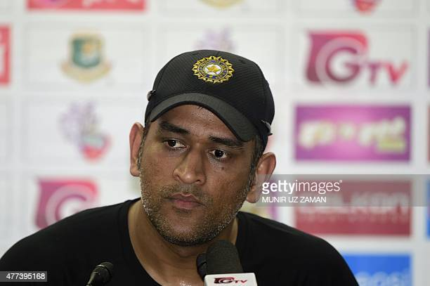 Indian cricket captain Mahendra Singh Dhoni speaks with the press after a practice session at the ShereBangla National Cricket Stadium in Dhaka on...