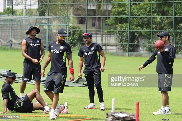 Indian cricket captain Mahendra Singh Dhoni Virat Kohli Shikhar Dhawan and Suresh Raina attend a practice session at the ShereBangla National Cricket...