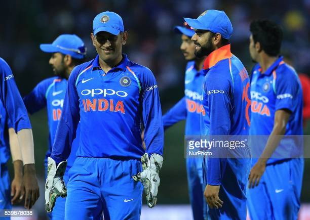 Indian cricket captain Virat Kohli and MS Dhoni walk back to pavilion at the end of Sri Lankan innings during the 3rd One Day International cricket...