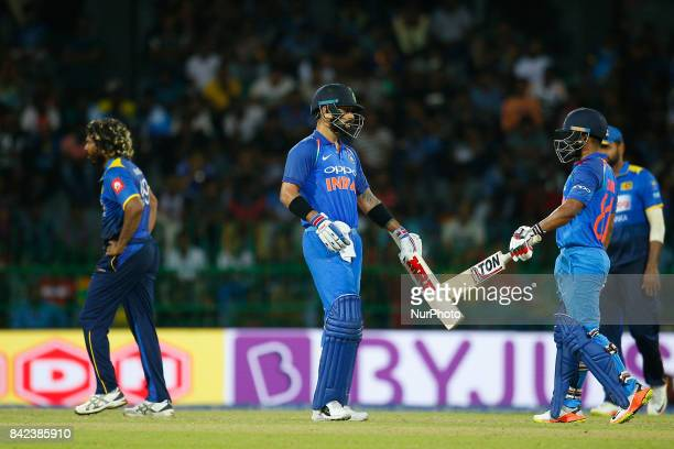 Indian cricket captain Virat Kohli and Kedar Jadhav congratulate each other during the 5th and final One Day International cricket match between Sri...