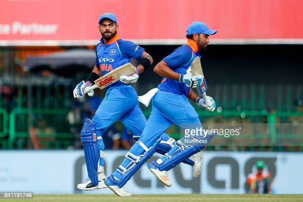 Indian cricket captain Virat Kohli and Rohit Sharma run between the wickets during the 4th One Day International cricket match between Sri Lanka and...