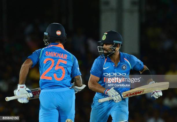 Indian cricket captain Virat Kohli and Shikhar Dhawan run between the wickets during the first One Day International cricket match between Sri Lanka...