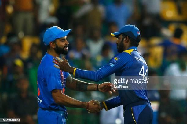 Indian cricket captain Virat Kohli and Sri Lankan cricket captain Upul Tharanga shake hands after India defeated Sri Lanka during the 1st and only...