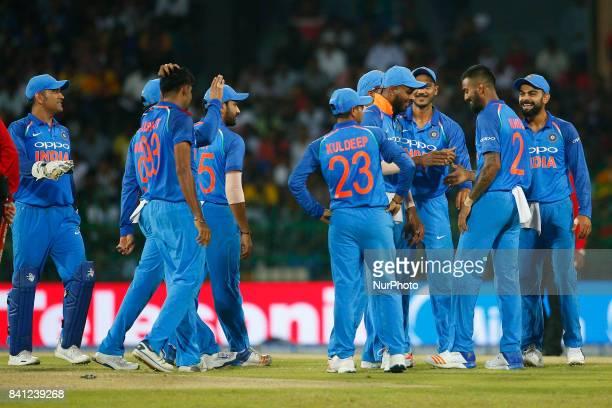 Indian cricket captain Virat Kohli and team members celebrate after the dismissal of Sri Lanka's Kusal Mendis the 4th One Day International cricket...