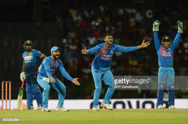 Indian cricket captain Virat Kohli and teammates Axar Patel and wicketkeeper Mahendra Singh Dhoni unsuccessfully appeal against Sri Lankan cricketer...