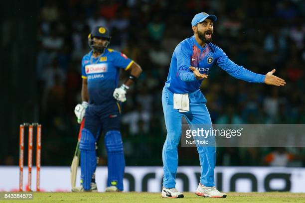 Indian cricket captain Virat Kohli appeals unsuccessfully during the 1st and only T20 cricket match between Sri Lanka and India at R Premadasa...