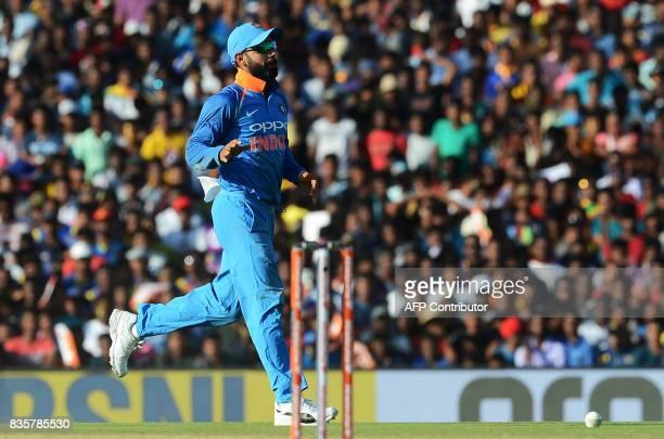 Indian cricket captain Virat Kohli celebrates after he dismissed Sri Lankan cricketer Chamara Kapugedara during the first One Day International...