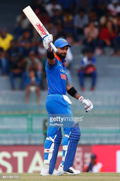 Indian cricket captain Virat Kohli celebrates after scoring 100 runs during the 4th One Day International cricket match between Sri Lanka and India...