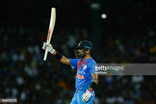 Indian cricket captain Virat Kohli celebrates after scoring 50 runs during the 1st and only T20 cricket match between Sri Lanka and India at R...