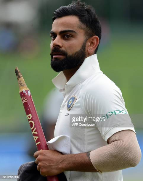 Indian cricket captain Virat Kohli celebrates after victory in the third day of the third and final Test match between Sri Lanka and India at the...