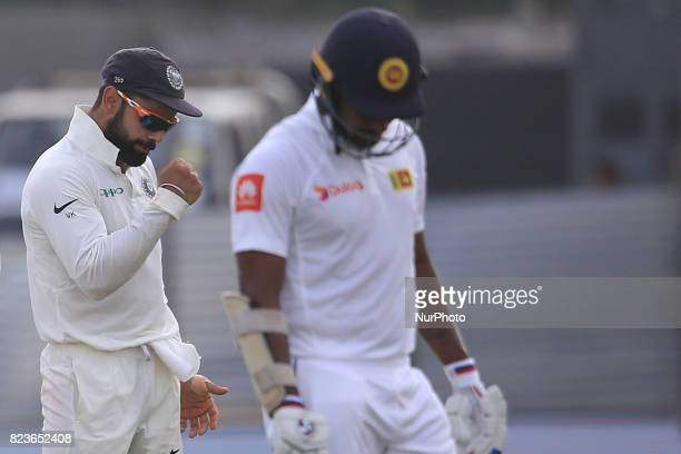 Indian cricket captain Virat Kohli celebrates as Sri Lanka's Danushka Gunathilaka walks back to the pavilion after being dismissed during the 2nd...