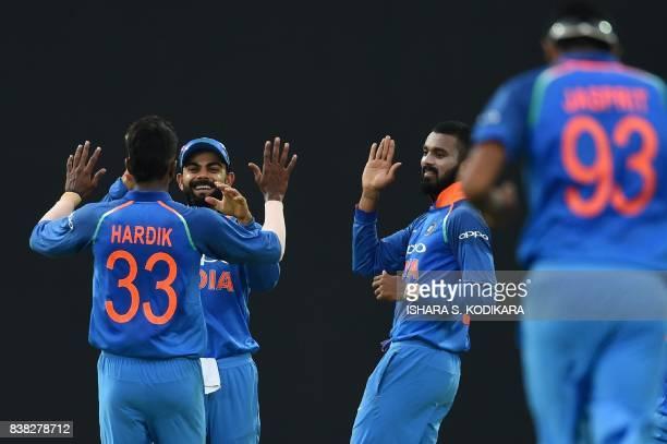 Indian cricket captain Virat Kohli celebrates with Hardik Pandya and Lokesh Rahul after he dismissed Sri Lanka's captain Upul Tharanga during the...