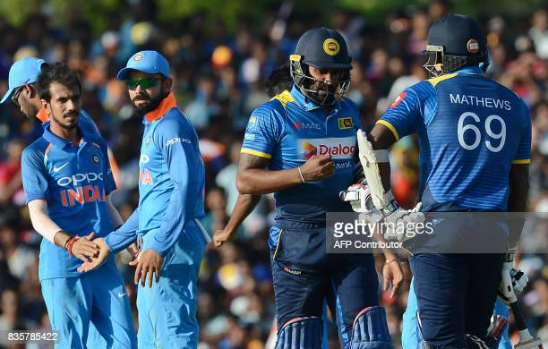 Indian cricket captain Virat Kohli celebrates with his teammates after he dismissed Sri Lankan cricketer Chamara Kapugedara during the first One Day...